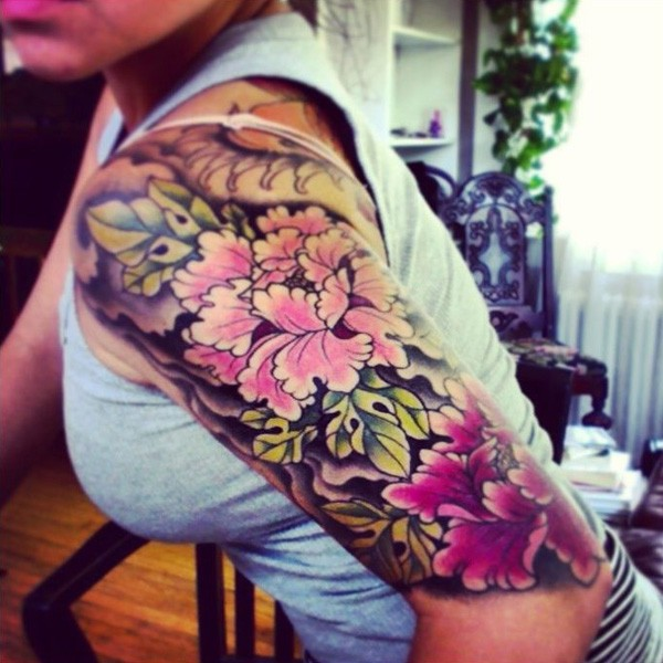 most attractive Peony tattoo on sleeve With colourful ink For Man And Woman