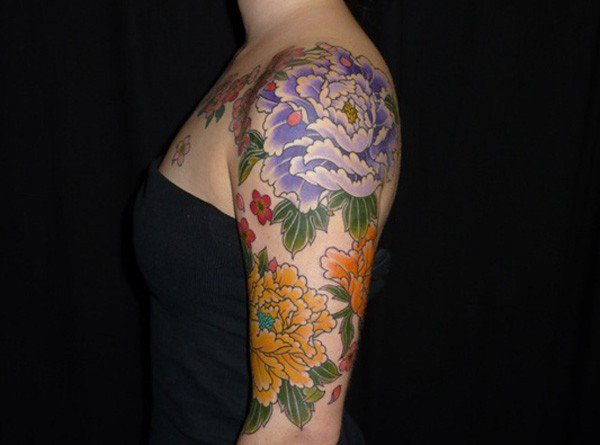 most beautiful Peony tattoo on sleeve on arm With colourful ink For Man And Woman