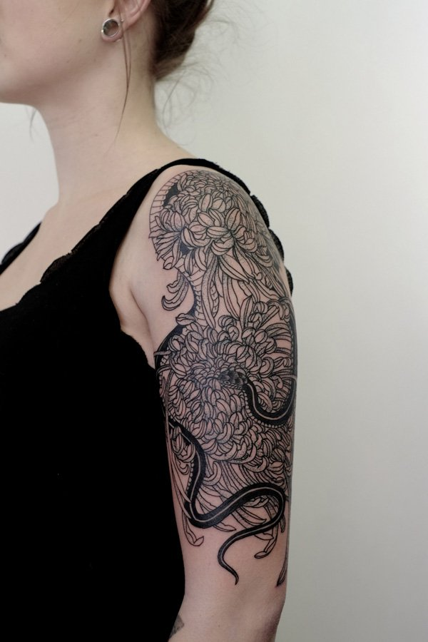 most dashing chrysanthemum half sleeve tattoo on arm With black ink For Man And Woma