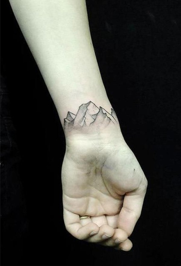 most incredible mountain tattoo on wrist With Black ink For Man And Woman