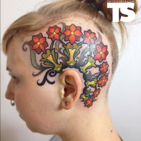 most incredible tattoo on the head With colourful ink For Man And Woman