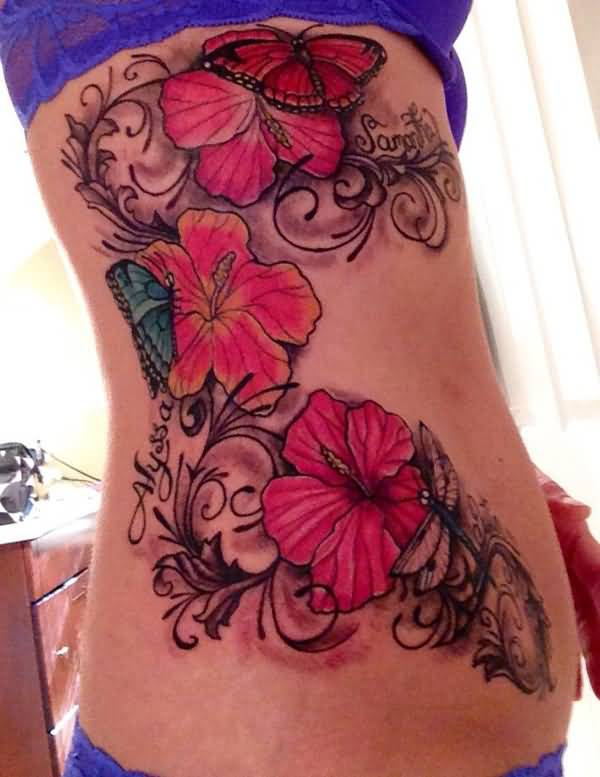 most wonderful Hibiscus tattoo on side With colourful ink For Man And Woman