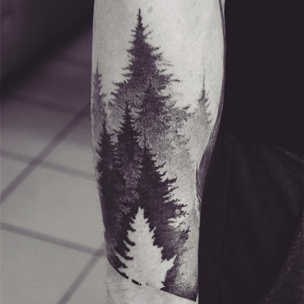 most wonderful forest tattoo for man on arm With Black ink For Man And Woman