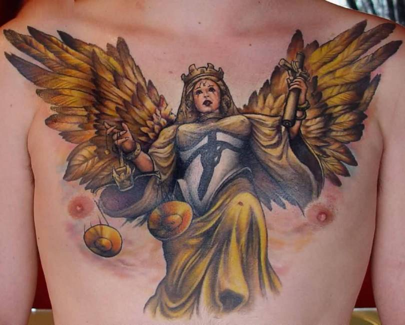 motivational yellow and black color ink angel tattoo on boy chest for boys made by expert artist Angel Chest Tattoo