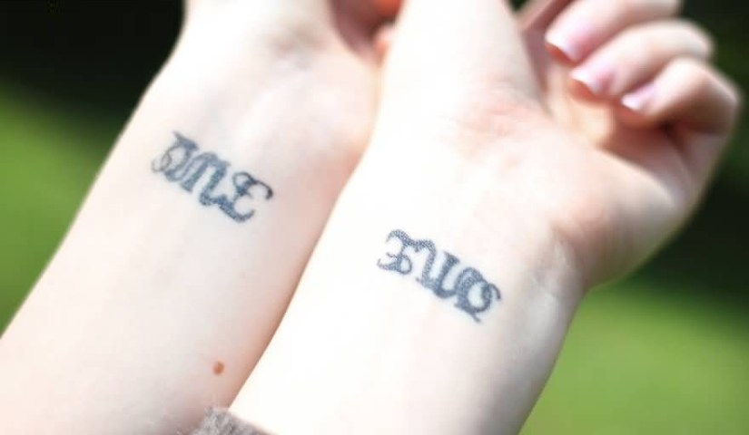 nice gray color ink ambigram word tattoo for man and woman