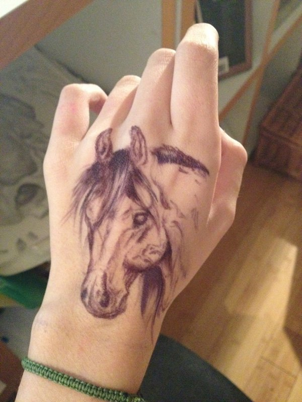 Nice Horse Tattoo On Hand On Hand With Black Ink For Women And Man