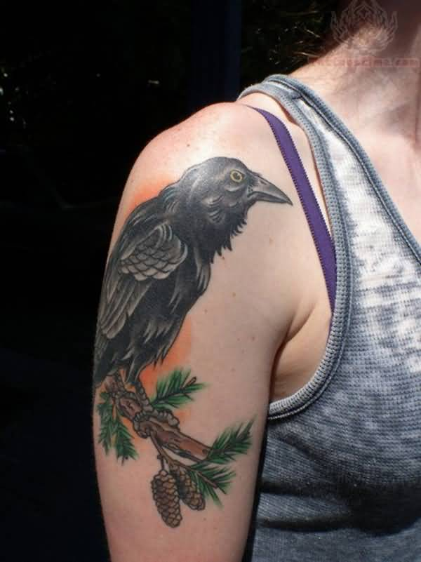 nice raven tattoo on arm with Black ink For Man And Woman