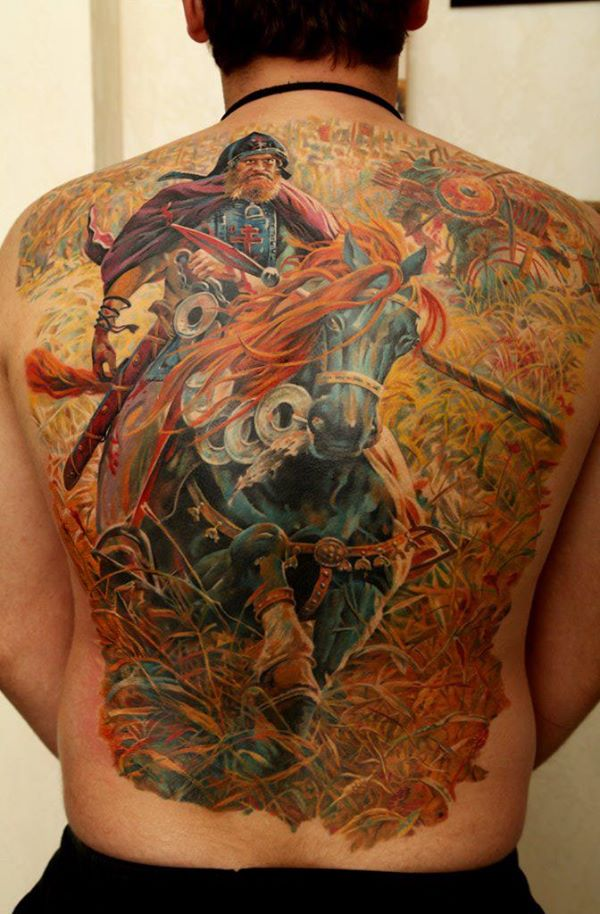 Nice Warrior Tattoo On Back With Colourful Ink For Women And Man