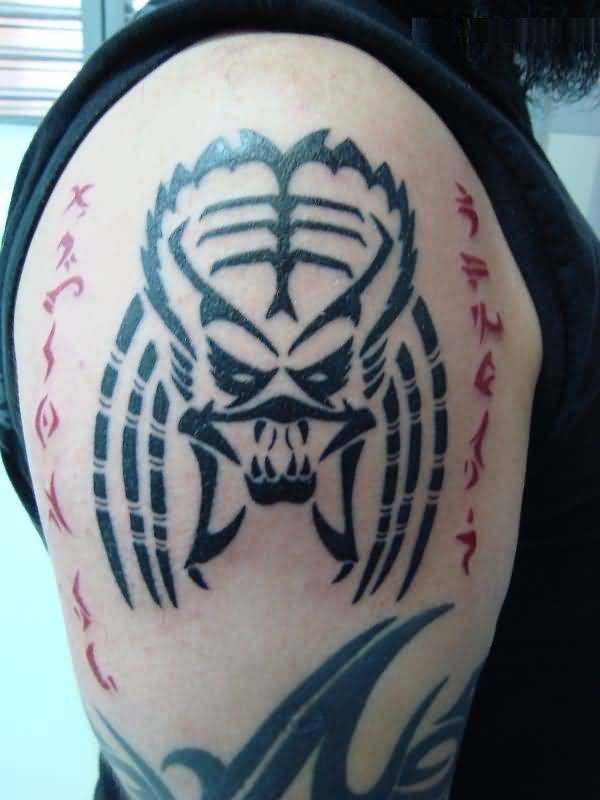 out standing gray color ink Predator Head Tattoo On Shoulder made by expert