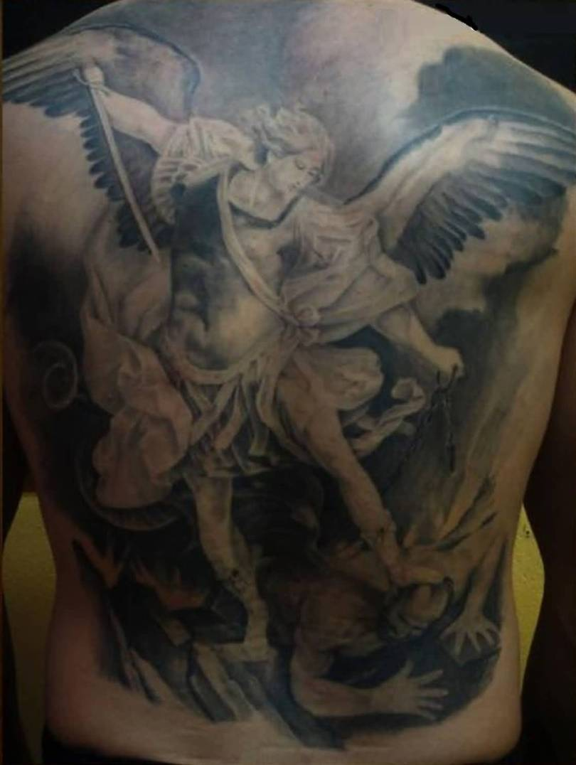 perfect gray and blue color ink angel warrior tattoo on boy's full back for boys only made by expert artist