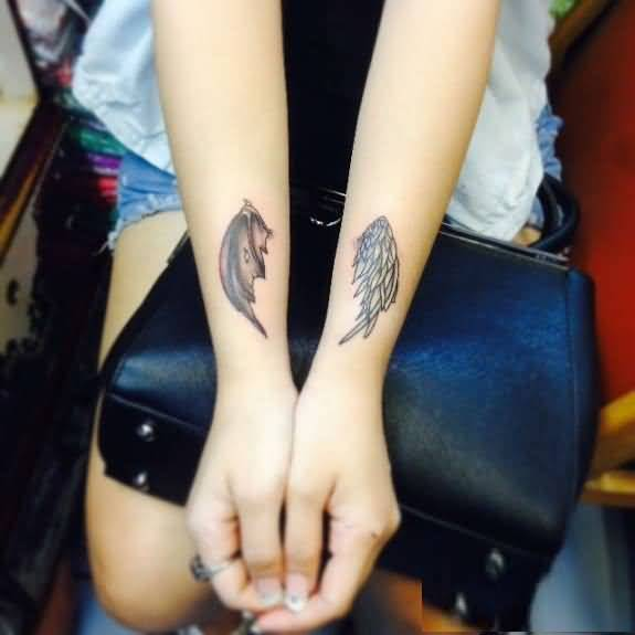 phenomenon black and red light color ink angel wings on girl's arm for girls made by expert person