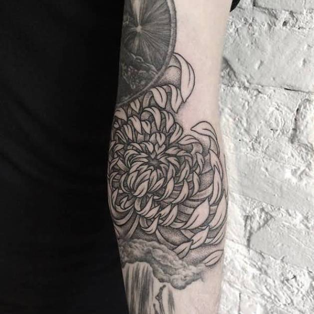 phenomenal chrysanthemum tattoo on arm With black ink For Man And Woma