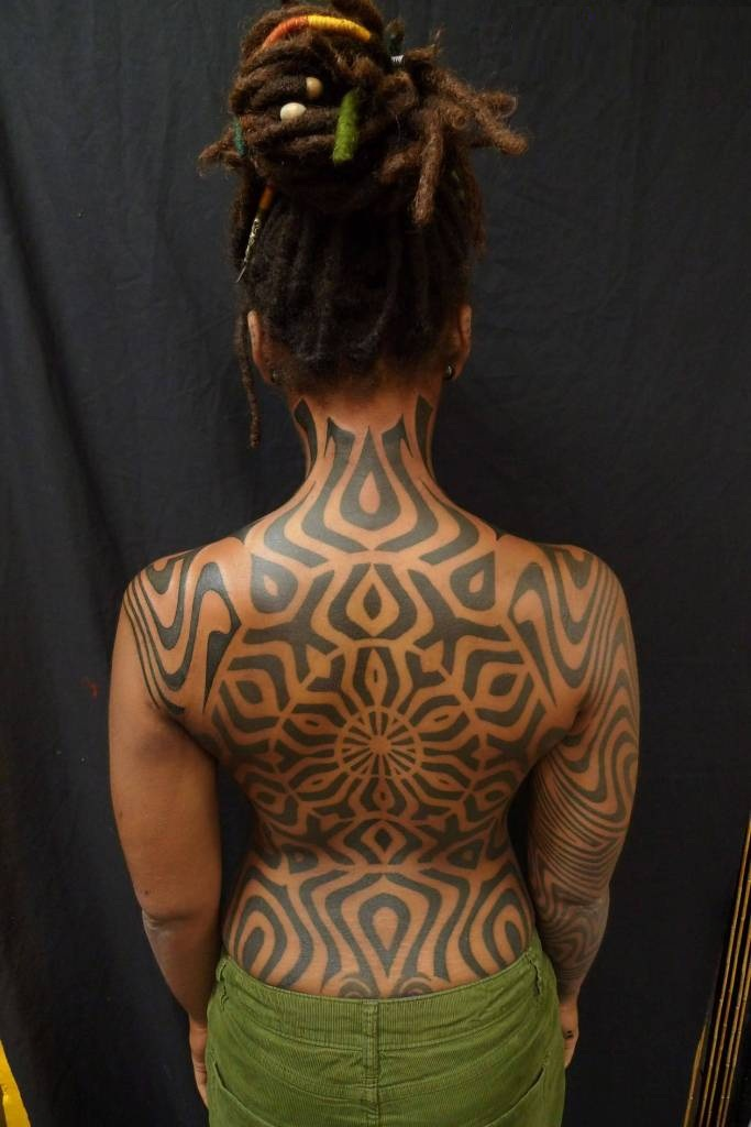 Sensation Beautiful Gray Ink African Tattoo On Girls Full Back