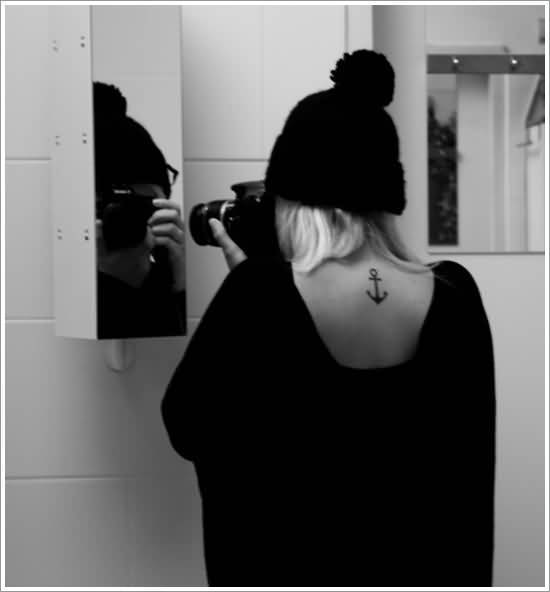 sensation black color ink anchor tattoo on girl's back side
