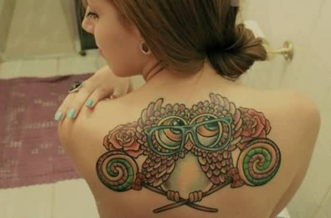 sensation red and green color ink animated owl tattoo on girl's back side for girls only made by expert