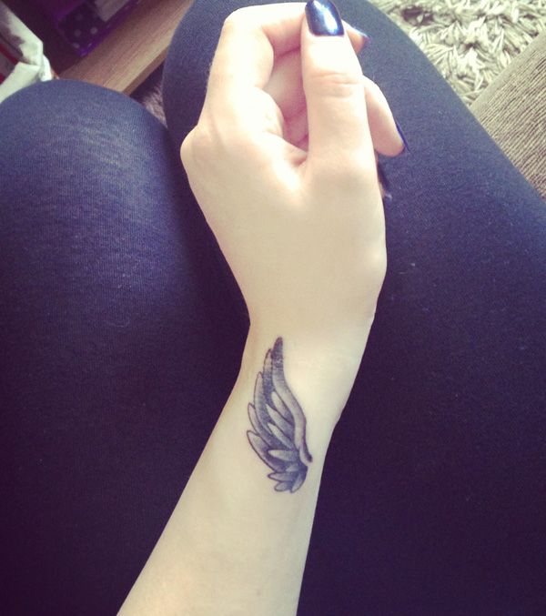 Simple Wing Tattoo On Wrist With Black Ink For Man Woman