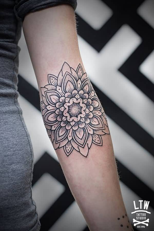 Stunning Mandala Tattoo On Arm With Black Ink For Man Woman
