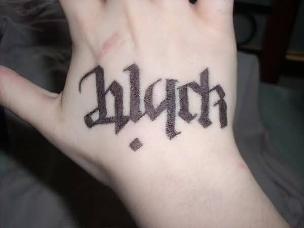 stunning black color ink ambigram tattoo on hand for girls