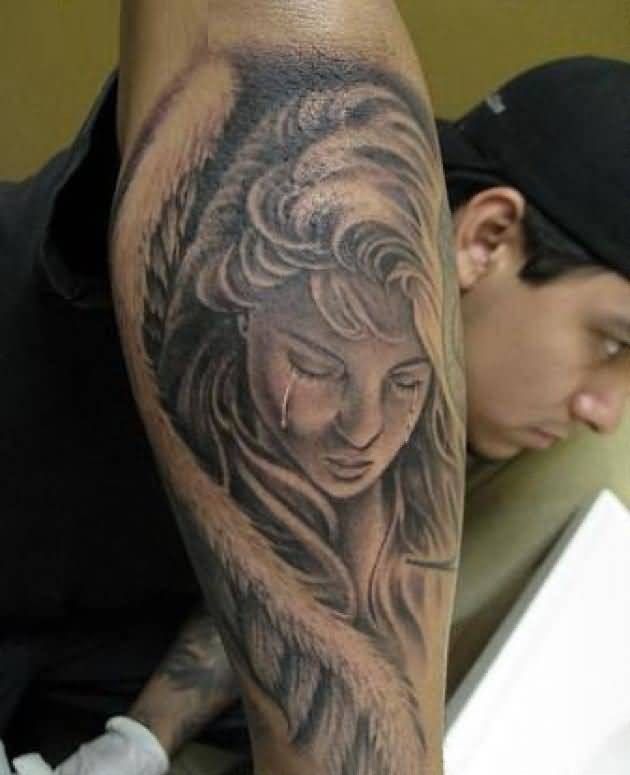 stunning black color ink angel tattoo on boy sleeve for boys made by expert with girl beautiful crying