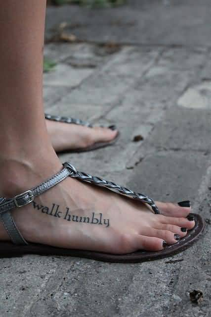 stunning gray color ink walk humbly ambigram tattoo on foot for boys