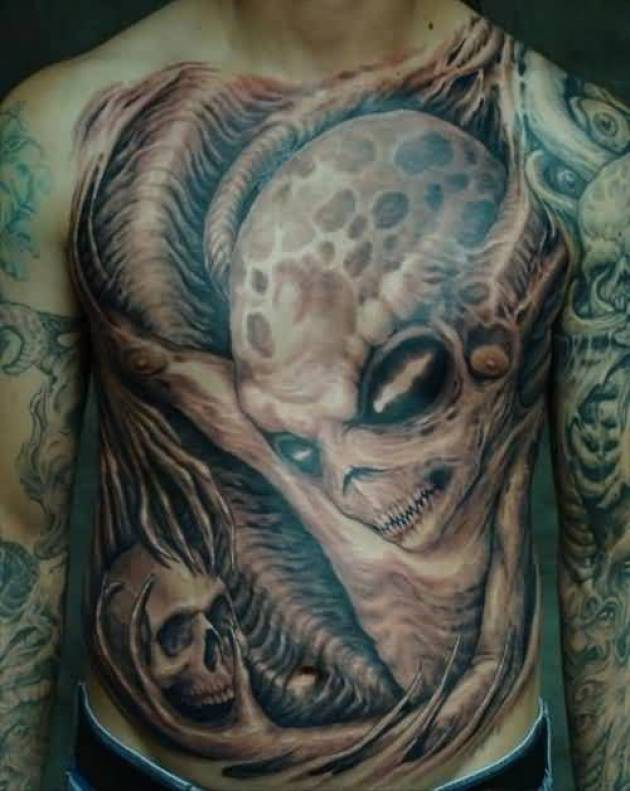 Superb Green And Red Light Color Light Ink Alien And Skull Tattoo On Mans Full Front Chest For Man
