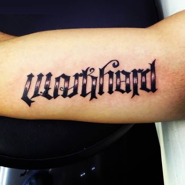sweet black color ink ambigram word tattoo on bicep made by expert