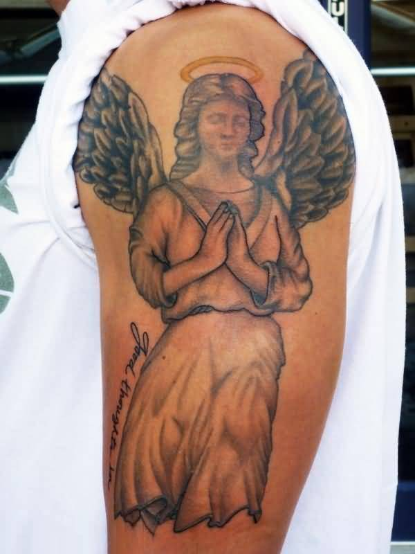 sweet gray color ink angel tattoo on boy sleeve for boys made by expert artist