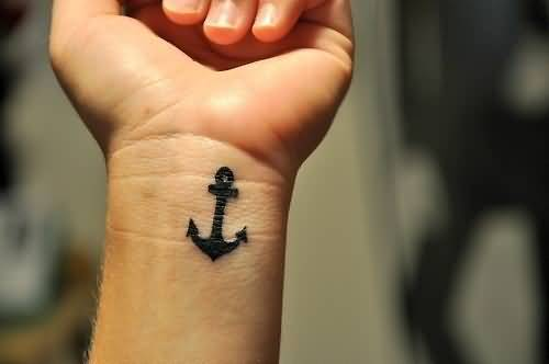 trendy black color ink anchor tattoo on arm for boys