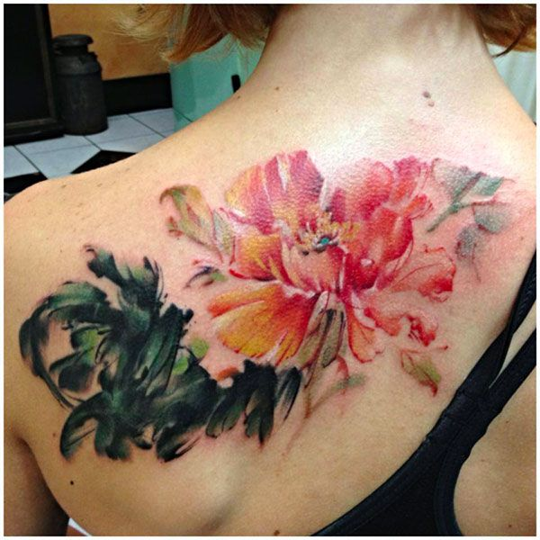 unqiue Watercolor style tattoos are gorgeous on back With colourful ink For Man And Woman