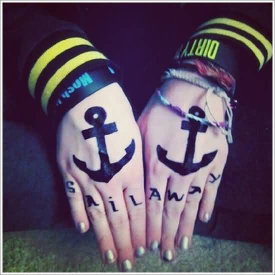 weird black color ink anchor tattoo on the hands made by expert