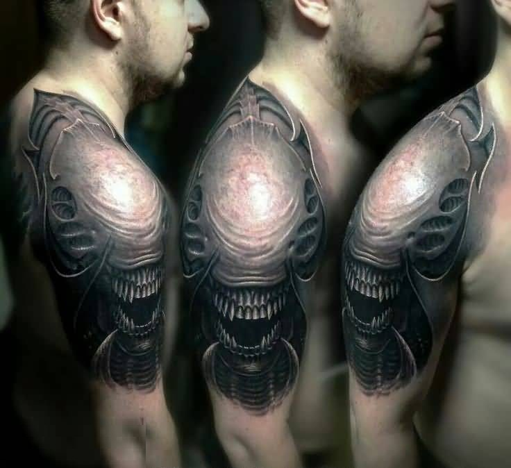 Weird Scary Alien Tattoo On Shoulder Photo