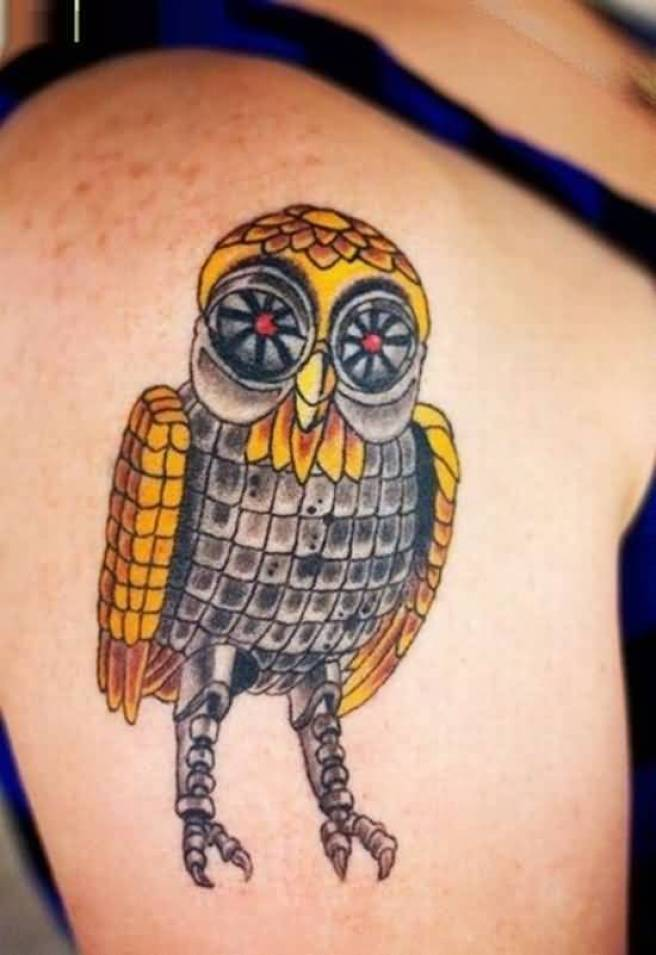 weird yellow and black color ink animated owl tattoo on girl's sleeve for girls only made by expert