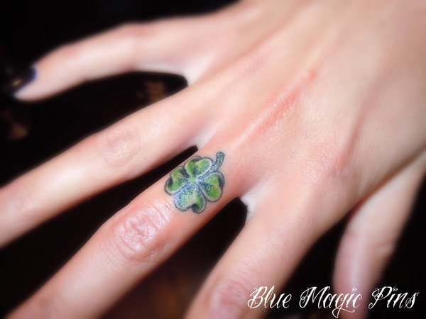 Wonderful Little Clover Finger Tattoo With Colourful Ink For Man And Woman