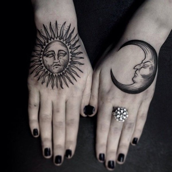 Wonderful Moon And Sun Tattoo On Hand With Black Ink For Man Woman