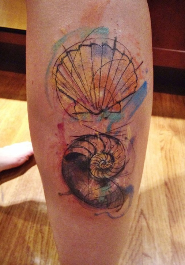 wonderful shell tattoo on calf With colourful ink For Man And Woman