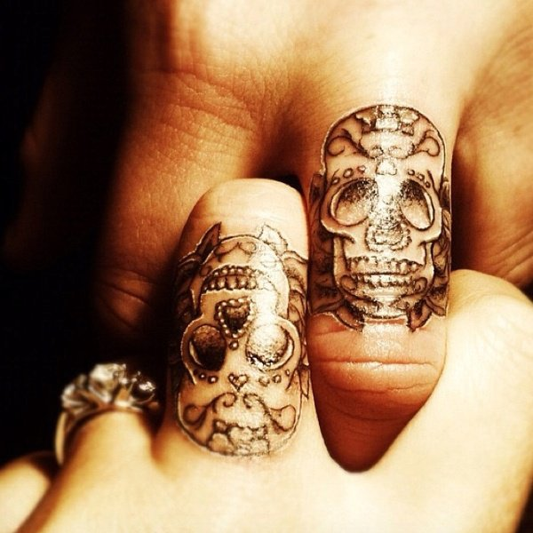 Wonderful Skull Finger Tattoo With Black Ink For Man And Woman