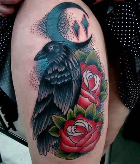 Adorable Green Red And Black Color Ink Crow And Rose Tattoos On Thigh For Girls
