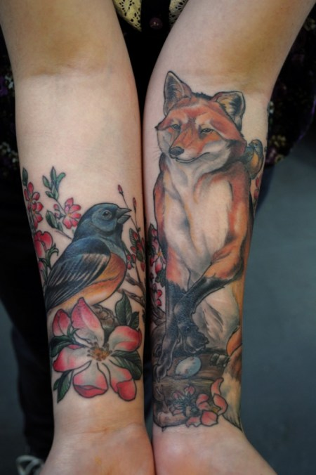 Adorable Red Green And Black Color Ink Bird & Wolf Tattoo Image For Girls On Arm