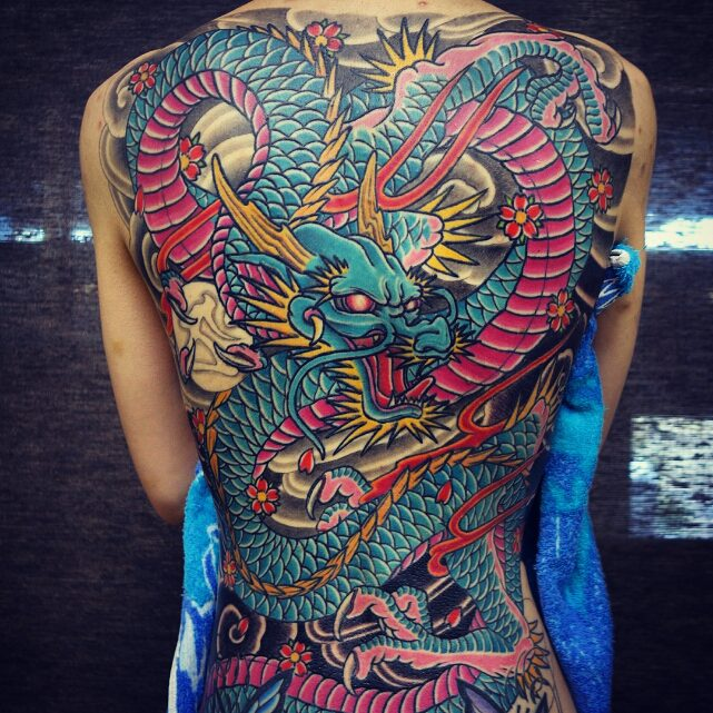 Amazing back tattoo with Colorful ink for man and woman