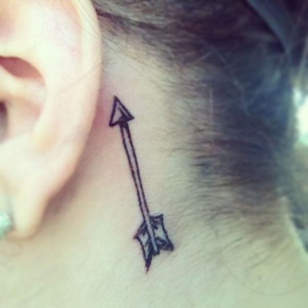 Attractive Black Color Ink Arrow Tattoo On Back Of Ear For Girls