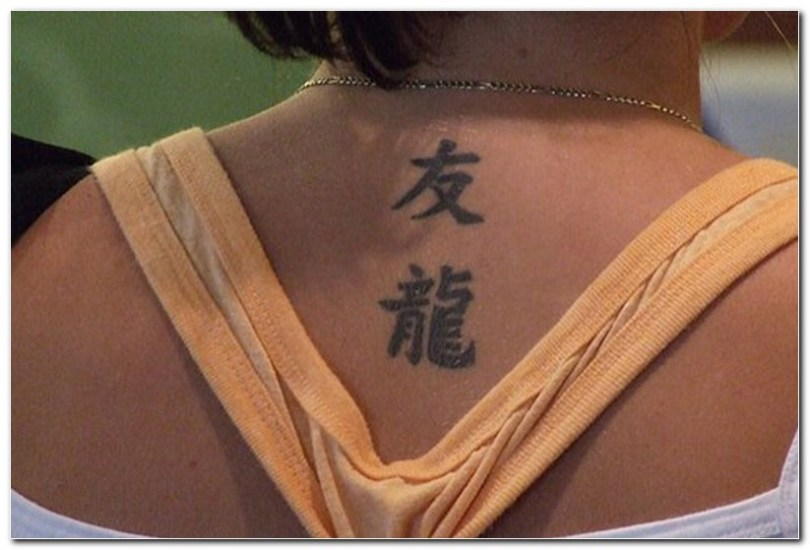Attractive Black Color Ink Chinese Tattoo Design On Neck Back For Girls