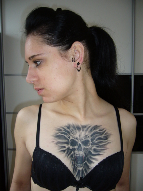 Attractive Black Color Ink Girl With Demon Tattoo On Chest For Girls