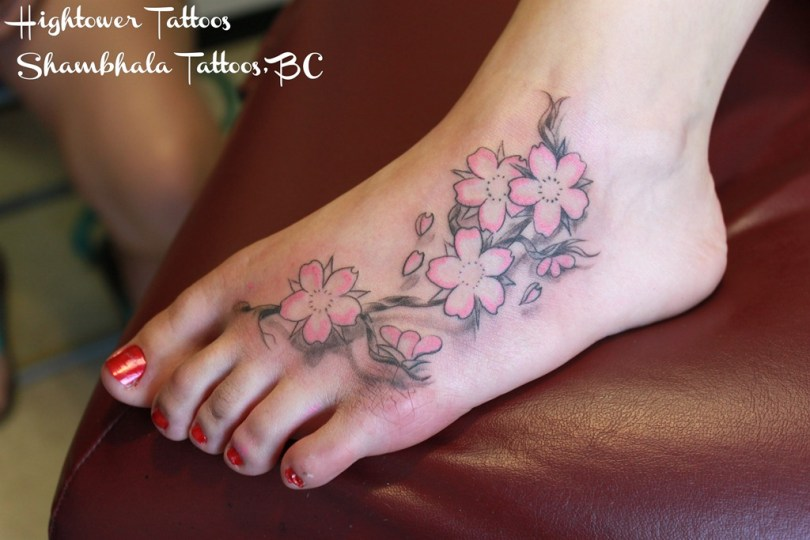 Awesome Black And Red Color Ink Cherry Blossom Tattoo On Foot For Girls