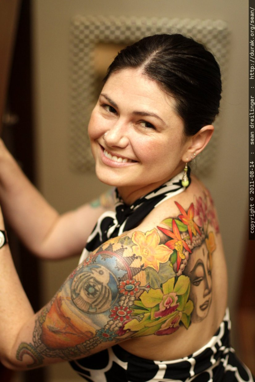 Awesome Green Red And Grey Color Ink Buddha Tattoo On Smiling Girl's Shoulder Back For Girls