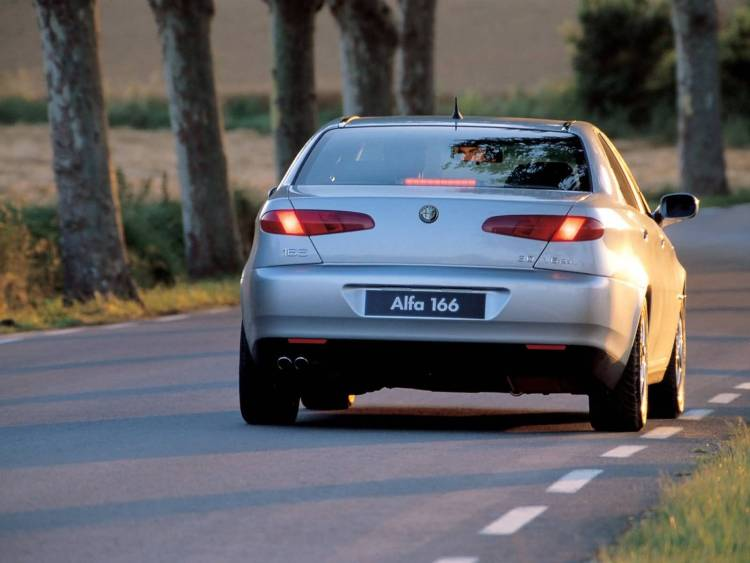 Back side of silver Alfa Romeo 166 Car on the road