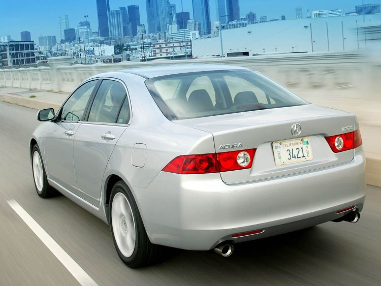 Back side view on the road of silver Acura TSX car