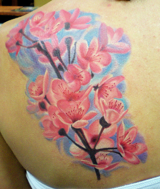 Best EVEr Blue Black And Red Color Ink Cherry Blossom Tattoo On Upper Back For Girls