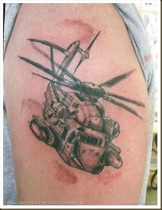 Brilliant Black Color Ink Army Helicopter Tattoo On Biceps For Boys