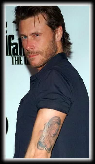 Brilliant Black Color Ink Celebrity Tattoo On Muscles For Boys