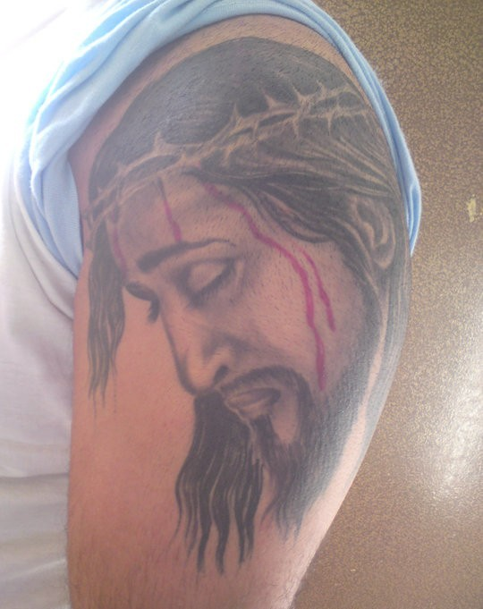 Charming Red And Black Color Ink Jesus Tattoo On Shoulder For Boys